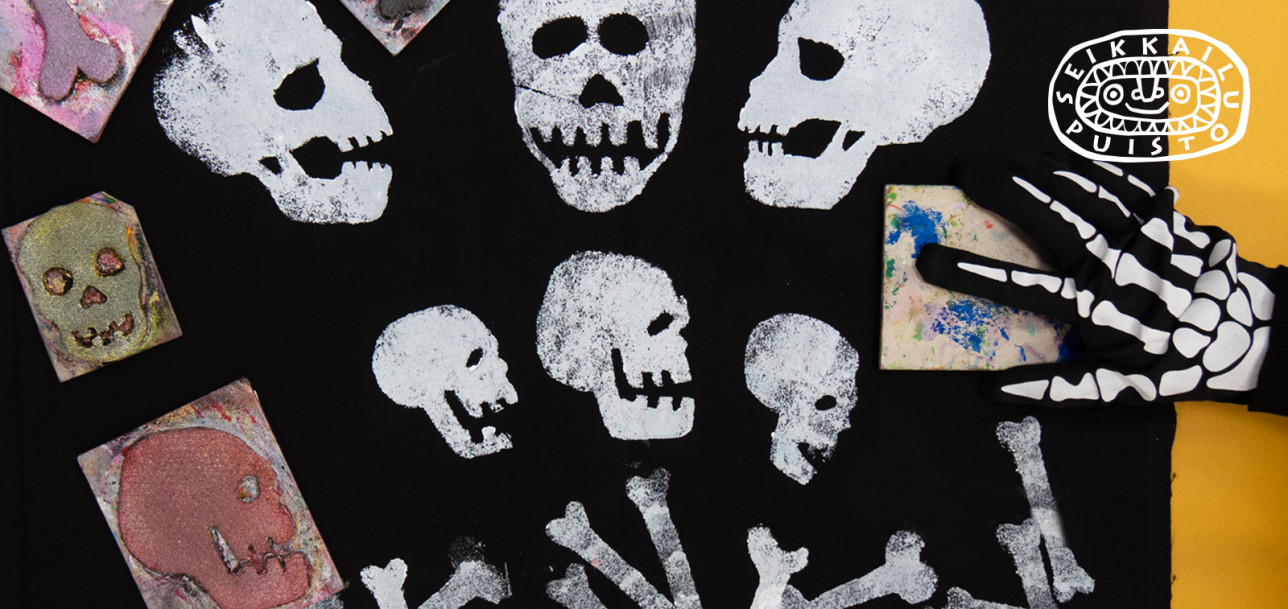 Musta kangas jossa on luurangon kuvia