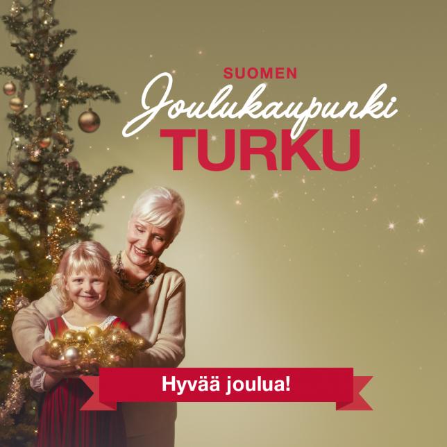 Joulukaupunki Turku toivottaa hyvää joulua. Mummo ja tyttö joulukuusen äärellä.