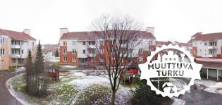 Asuintaloja ja Muuttuva Turku -tunnus