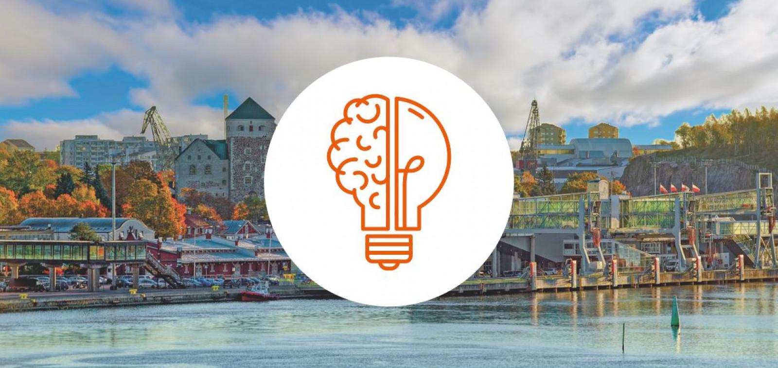 Kuvituskuva jossa taustalla Turku ja keskellä kuva hehkulampusta