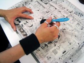 sarjakuvien piirtoa